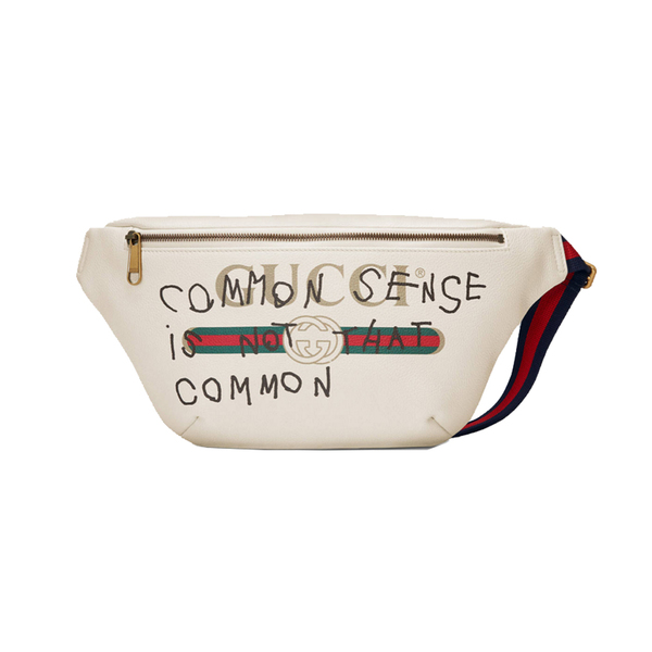 5cef60831a18 GUCCI. Coco Capitán Logo Belt Bag. This leather belt bag is printed ...