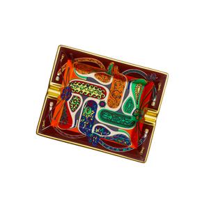 Medium festival des amazones ashtray in decorative limoges porcelain with suede goatskin base 16 x 20 cm  hermes